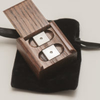 Luxor Premium Titanium alloy precision dice with oak puzzle box. Precision CNC machined balanced 16mm die sets